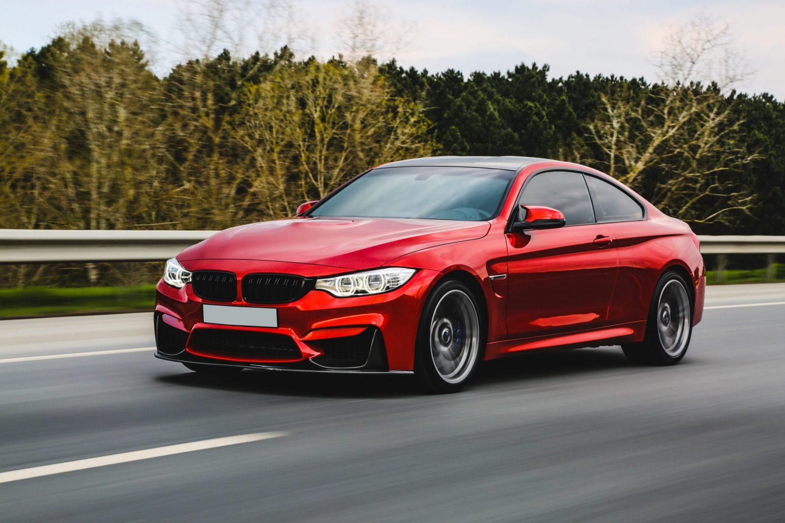 red-luxury-sedan-on-the-road